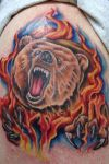 bear tattoo on shoulder
