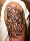 dog head tattoo on left arm