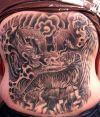 tiger and dragon fights tattoo