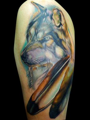Wolf Head And Feather Tattoo