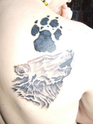 Wolf Head And Paw Tattoo On Back