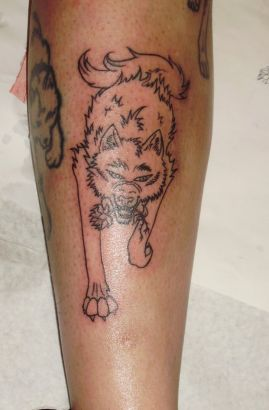 Wolf With Flower Tattoo
