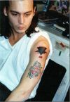 johnny depp left arm tattoo