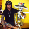 nikki sixx arm and leg tattoo