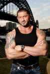 dave batista dragon and flag tattoo on arm