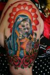 egyptian tats on girl shoulder
