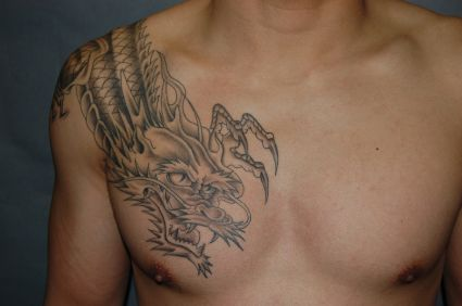 man with dragon on tat chest tattoo from itattooz. Black Bedroom Furniture Sets. Home Design Ideas