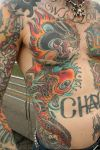 koi fish tats on man's stomach