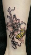 flower with bee tattoo