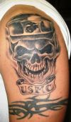 skull and tribal tat on arm