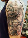 angel fighting demon tattoo on arm