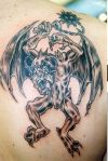 demon tattoos on right shoulder blade