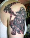 grim reaper tattoo pics on right arm