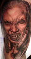 vampire girl face tattoos on arm