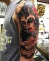 vampire girl tattoos on left arm
