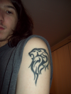 leo tattoo pic on left arm