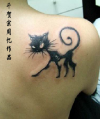 black cat on right shoulder blade
