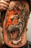 lion heads tattoo on rib