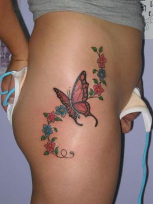 Flowers And Butterfly Image Tattoo On Hip