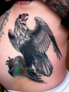eagle tattoo on back for girl