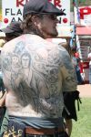man's full back tattoo