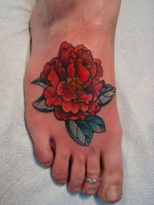 Japanese Flower Tattoo On Feet Tattoo From Itattooz