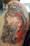 fired japanese dragon tats