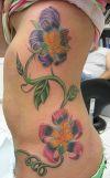 lily flower women's rib tattoo