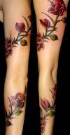 Rose tat on hand