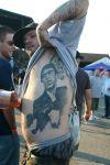 man tattoo on rib
