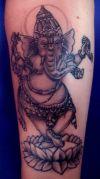 ganesh tattoo stand on lotus