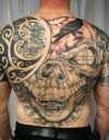 skull tat man's back