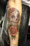 skull and rose tat on arm