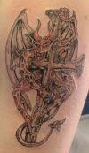 demon and cross tattoo