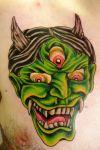 demon tattoo on chest